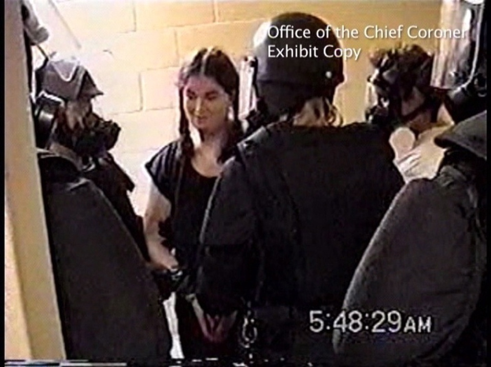 Ashley Smith is shown surrounded by guards in this image made from video at the Joliette Institution in Joliette, Que., July 26, 2007. (Office of the Chief Coroner for Ontario)