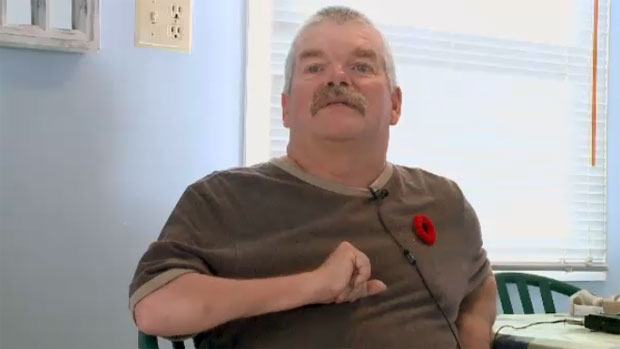 Cerebral palsy has left Steve Weatherby paralyzed on one side of his body, requiring him to use a motorized scooter to get around.