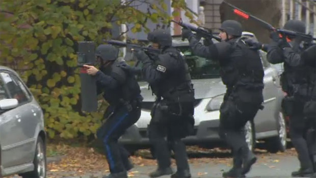 Police stormed the home around 2 p.m., armed with rifles and flak jackets.