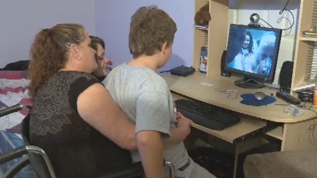 Colleen McCann and her family Skype with her birth mother and her family in Ontario on Nov. 23, 2012.