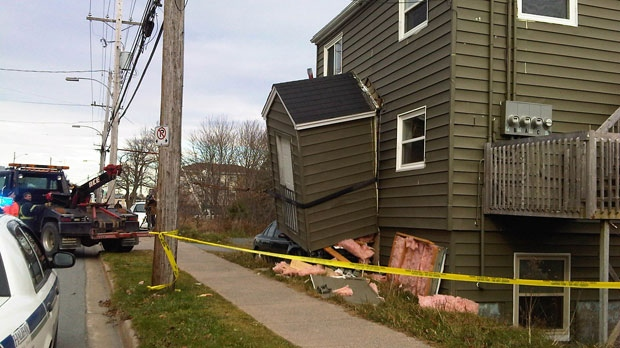 Police are investigating after a car crashed into a home outside Halifax Tuesday morning.