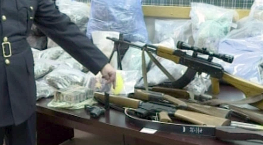 Police seized several deadly weapons and hundreds of thousands of dollars worth of street drugs Tuesday's bust.