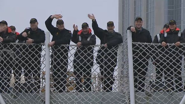 Sailors aboard HMCS Toronto bid farewell as the warship departs Halifax on Jan. 14, 2013.