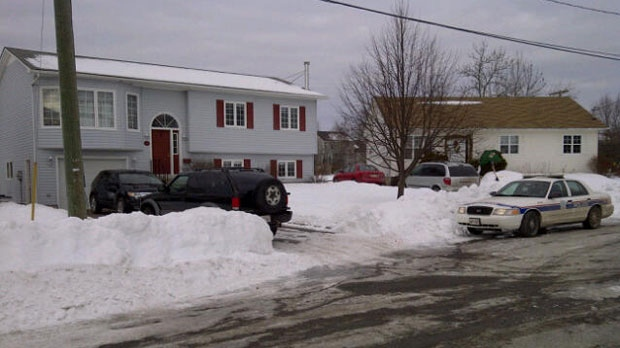 Police surrounded a home outside New Maryland after a woman was shot early Tuesday in a Fredericton neighbourhood.