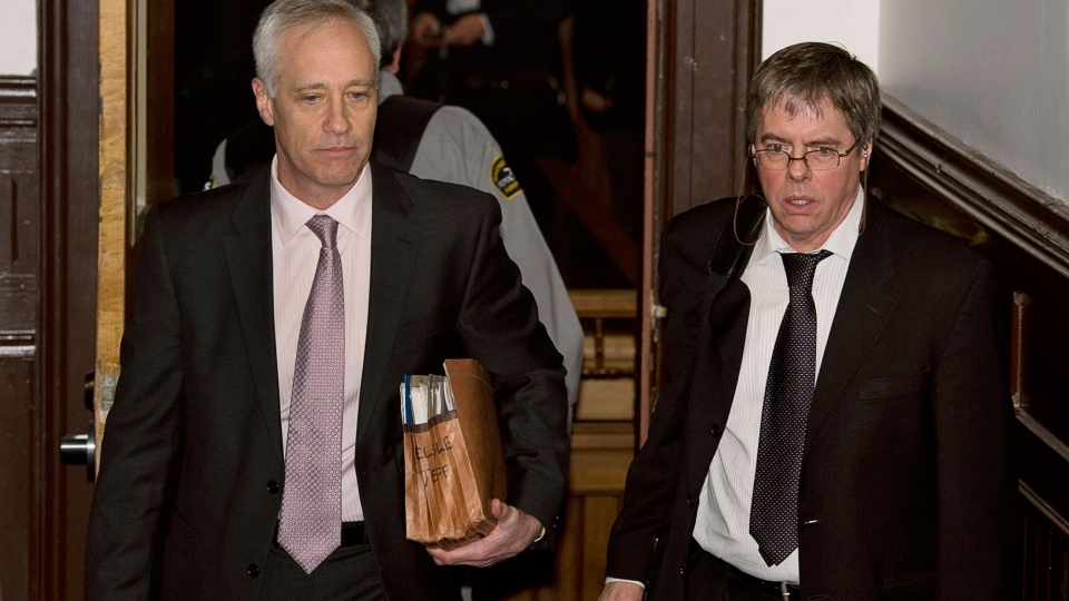Mike Taylor, left, lawyer for Sub-Lt. Jeffrey Paul Delisle, and defence witness Wesley Wark, an intelligence and security expert, head from a sentencing hearing at Nova Scotia provincial court in Halifax on Thursday, Jan. 31, 2013. (Andrew Vaughan / THE CANADIAN PRESS)
