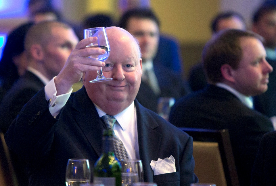 Senator Mike Duffy holds up his glass during the Maritime Energy Association's annual dinner in Halifax on Wednesday, Feb. 6, 2013. (THE CANADIAN PRESS/Devaan Ingraham)