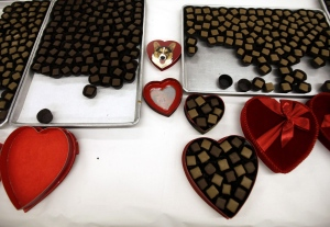 Fudge-covered chocolates wait to be placed in heart-shaped boxes that were to be sold at the Susie's South Forty Confections stores in Midland and Odessa, Texas for Valentine's Day, Thursday, Feb. 7, 2013. (Odessa American, Edyta Blaszczyk)