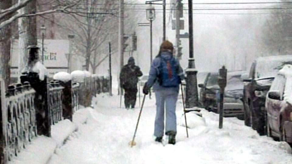 Residents use the snow to their advantage, making their way through town on skis in downtown Fredericton, N.B., Sunday, Feb. 17, 2013.