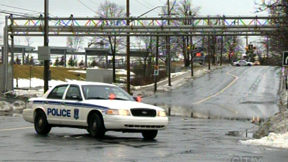 Police block a flooded road in Dartmouth, N.S., Sunday, Feb. 17, 2013.