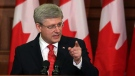 Prime Minister Stephen Harper speaks to his caucus on Parliament Hill, in Ottawa, Tuesday May 21. (Fred Chartrand / THE CANADIAN PRESS)
