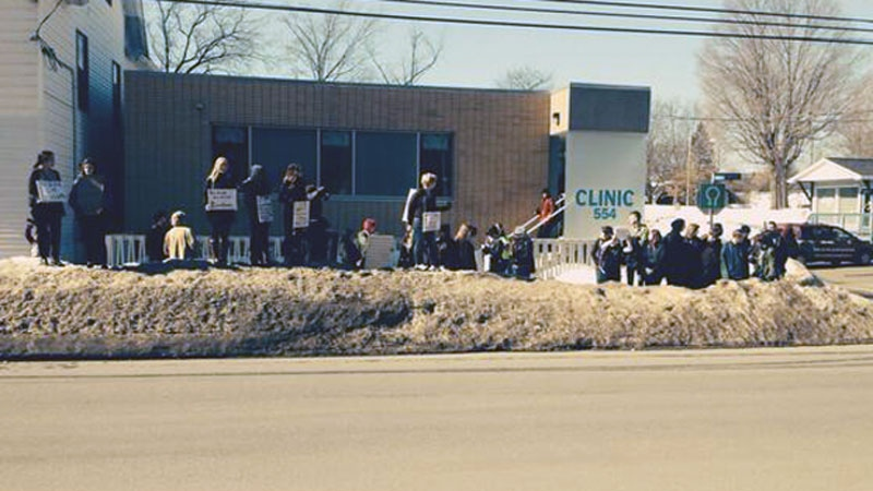 Pro-abortion supporters gather outside the Morgentaler Clinic in Fredericton after it was announced the facility would be closing. (CTV Atlantic)
