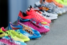 The soccer cleats of the Uruguayan team players are placed on the side of the field before a training session at Jacare Stadium in Sete Lagoas, Brazil, on Tuesday, June 10, 2014. (AP Photo/Victor R. Caivano)