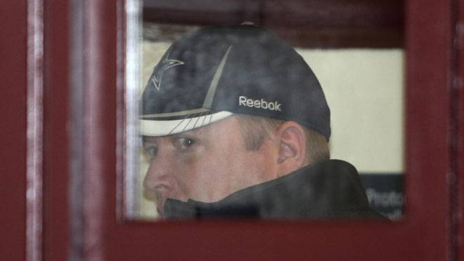 Canadian Forces intelligence officer Jeffrey Paul Delisle is led from Halifax provincial court Monday, Jan. 16, 2012. (Halifax Chronicle Herald)