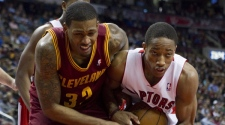 Toronto Raptors' DeMar DeRozan (right) wrestles for the ball with Cleveland Cavaliers' Alonzo Gee during first half NBA basketball action in Toronto on Friday April 6 , 2012. THE CANADIAN PRESS/Chris Young