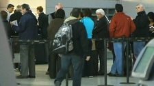 Travellers form a line at Pearson Airport in Toronto on Friday, April 13, 2012.