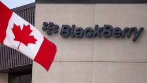 A Canadian flag flies at BlackBerry's headquarters in Waterloo, Ont., July 9, 2013. (Geoff Robins / THE CANADIAN PRES)