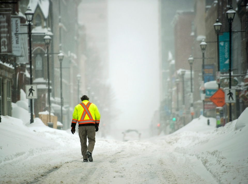 A pedestrian walks on a downtown street in Halifax on Wednesday, March 18, 2015. (Andrew Vaughan / THE CANADIAN PRESS)
