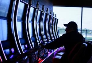 A visitor to the Resorts World Casino at the Aqueduct racetrack plays an electronic slot machine in New York on Friday, Oct. 3, 2014. (AP / Julie Jacobson)