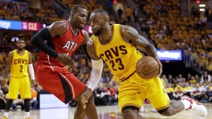 Cleveland Cavaliers forward LeBron James (23) drives to the lane against Atlanta Hawks forward Paul Millsap (4) in the second half of Game 4 of the NBA basketball Eastern Conference Finals, Tuesday, May 26, 2015, in Cleveland. (AP Photo/Tony Dejak)