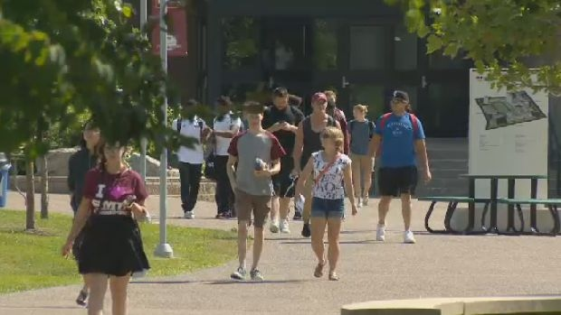Students returning to Saint Mary's University campus in Halifax.