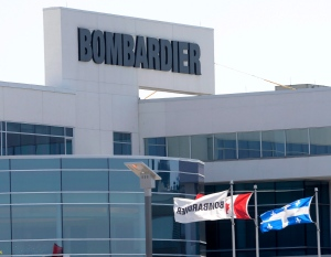 Flags fly outside a Bombardier plant in Montreal, Thursday, May 14, 2015. (Ryan Remiorz / THE CANADIAN PRESS)
