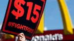 In this July 22, 2015 file photo, supporters of a $15 minimum wage for fast food workers rally in front of a McDonald's in Albany, N.Y.  (AP Photo/Mike Groll)