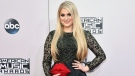 In this Nov. 23, 2014 file photo, Meghan Trainor arrives at the 42nd annual American Music Awards in Los Angeles. (Photo by John Shearer/Invision/AP)