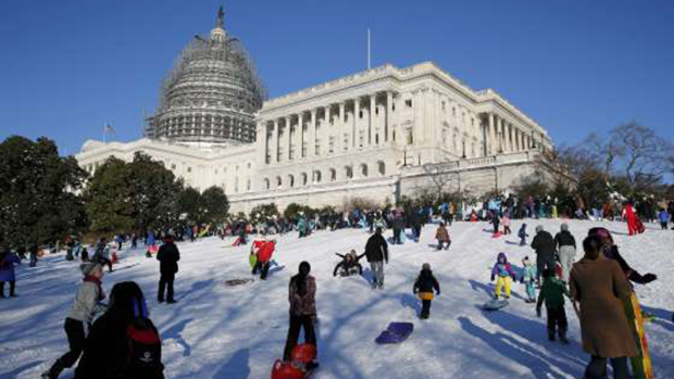 You don't often see children sliding down Capitol Hill.  The weekend snowfall was one for the record books!