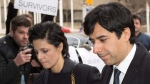 Jian Ghomeshi walks in front of protesters as he arrives at a Toronto courthouse with his lawyer Marie Henein, left, on Feb. 4, 2016. (Frank Gunn / THE CANADIAN PRESS)
