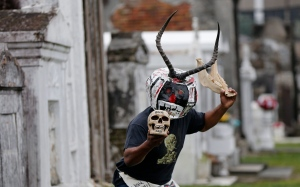 Bruce 'Sunpie' Barnes, head of the Mardi Gras North Side Skull & Bone Gang, poses with his accoutrements for Mardi Gras day in a cemetery in New Orleans, Thursday, Jan. 7, 2016. (AP/Gerald Herbert)