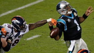 Denver Broncos' Von Miller strips the ball from Carolina Panthers' Cam Newton on Feb. 7, 2016. (Charlie Riedel / AP)