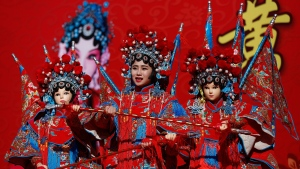 A Chinese dancer dressed in the traditional costume performs a cultural dance on stage during a temple fair for a Lunar New Year celebration in Beijing, Monday, Feb. 8, 2016. (AP / Andy Wong)