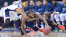 Halifax Hurricanes Joseph Bertrand, left, defends against Saint John Mill Rats Gabe Freeman in National Basketball League of Canada action in Halifax on Thursday, Jan. 28, 2016. (THE CANADIAN PRESS/Andrew Vaughan)