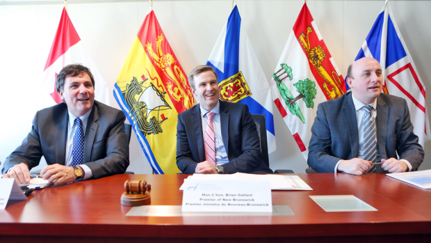 New Brunswick Premier Brian Gallant, centre, hosts a meeting of the Atlantic premiers and members of the federal cabinet representing Atlantic Canada in Fredericton on Feb. 10, 2016. At left is Dominic LeBlanc, Leader of the Government in the House of Commons, and Jordan O'Brien, right, chief of staff for the office of the premier. (THE CANADIAN PRESS/James West)