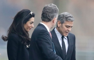 George Clooney, right, and his wife Amal Clooney, left, are accompanied by Merkel's foreign policy adviser Christoph Heusgen as they leave chancellery after private meeting with German chancellor Angela Merkel in Berlin, Germany, Friday, Feb. 12, 2016. (AP Photo/Markus Schreiber)