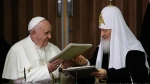Pope Francis, left, and Russian Orthodox Patriarch Kirill exchange a joint declaration on religious unity at the Jose Marti International airport in Havana, Cuba, Friday, Feb. 12, 2016. (AP / Gregorio Borgia)
