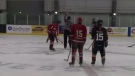 Players line up for a faceoff at the Pictou County Bantam Memorial Hockey Tournament.