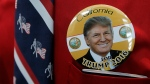 Donald Trump supporter Robert Tally wears a button of Trump before the California Republican Party 2016 Convention in Burlingame, Calif., Friday, April 29, 2016. (AP / Jeff Chiu)