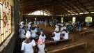 Worshipers gather at Holy Christ Church in Dolo Town, Liberia. They lost 36 members of the congregation to Ebola. (George Reeves)