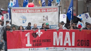 May Day demonstrators protest in Montreal, Sunday, May 1, 2016. (THE CANADIAN PRESS / Graham Hughes)