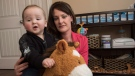 Sacha DeWolfe is shown with her son Lennon in their home in Charters Settlement, just south of Fredericton, Tuesday May 3, 2016. DeWolfe is calling for changes to the province's Human Rights Act because she says a spa discriminated against her when staff said she couldn't bring her five-month old son along to an appointment. (THE CANADIAN PRESS/Stephen MacGillivray)