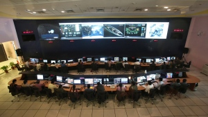 Indian Space Research Organization (ISRO) scientists and engineers monitor the movements of India's Mars orbiter at their Spacecraft Control Centre in Bangalore, India, on Nov. 27, 2013. (Aijaz Rahi / AP)