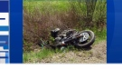 A motorcycle damaged on the side of the road after a pile-up near Belleisle, N.B.