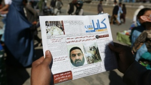 An Afghan man reads a local newspaper with photos the former leader of the Afghan Taliban, Mullah Akhtar Mansoor, who was killed in a U.S. drone strike last week, in Kabul, Afghanistan on Wednesday, May 25, 2016. (AP / Rahmat Gul)