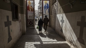 Coptic Christians walk outside St. Markos Church in Minya, south of Cairo on Tuesday, Jan. 6, 2015. (AP / Roger Anis)