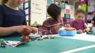 Children testing toys