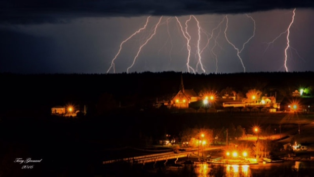 Ligtning strikes over Sainte-Marie-de-Kent.  This amazing photo was taken last month by Terry Girouard.