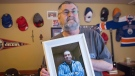 Ernie LeBlanc holds a photo of his son Jason LeBlanc at their home in Sydney Mines, N.S. on Monday, March 14, 2016. Jason died in custody at the Cape Breton Correctional Centre in January. (THE CANADIAN PRESS/Andrew Vaughan)