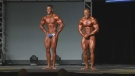 Two bodybuilders pose on stage at a bodybuilding competition in Moncton, N.B., on Saturday, June 25, 2016.