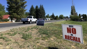 Signs in Burns, Ore., urge voters to keep Harney County Judge Steve Grasty, who activists have criticized for his treatment of wildlife refuge standoff protesters, in this photo taken on  June 21, 2016. (AP / Andrew Selsky)